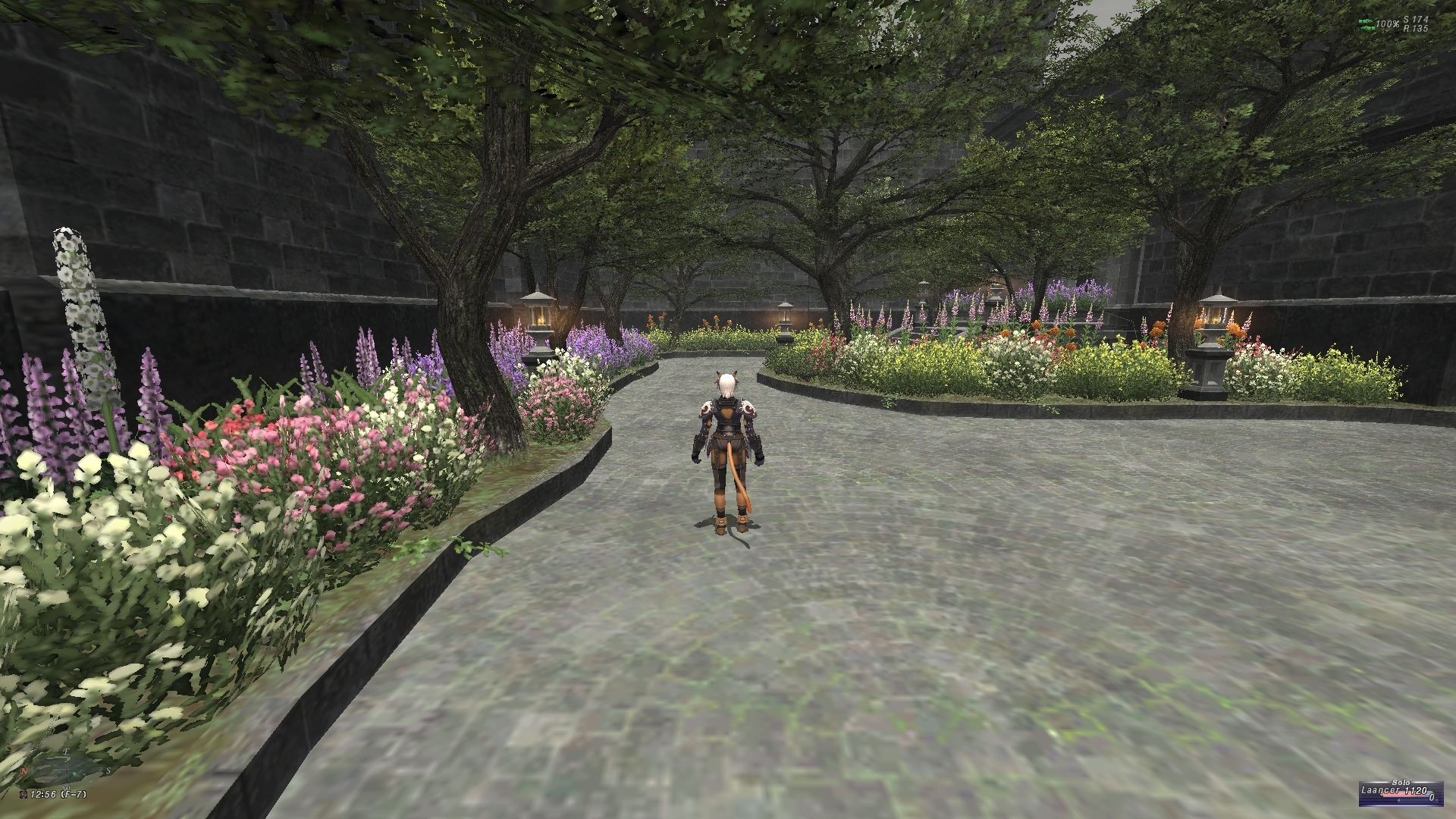 videogame avatar stands with back to camera in brick-floored garden.