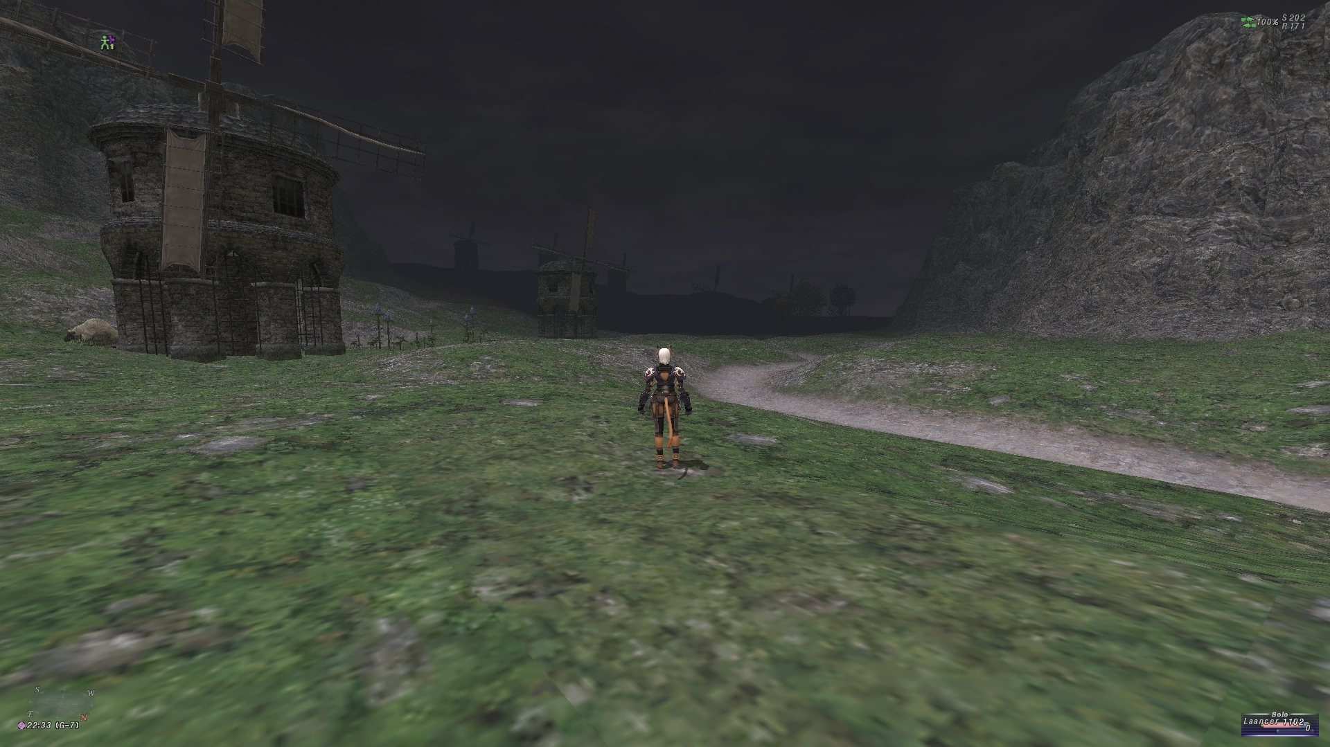 videogame character stands with back to camera. Decrepit windmills occupy the midground and background.