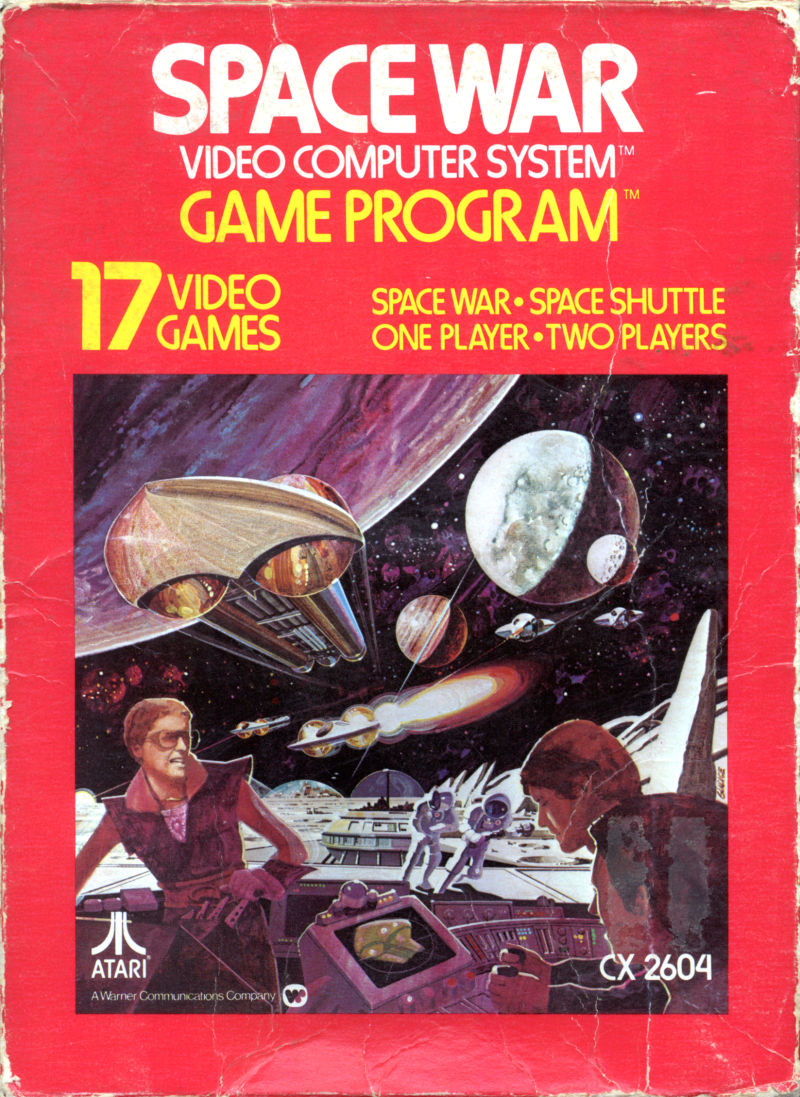 Bright red computer game packaging. Text reads: 'SPACE WAR, VIDEO COMPUTER SYSTEM, GAME PROGRAM; 17 VIDEO GAMES, SPACE WAR; SPACE SHUTTLE, ONE PLAYER, TWO PLAYERS.' Spaceships and planets lie in background, human at computer stations sit in foreground of cover image.