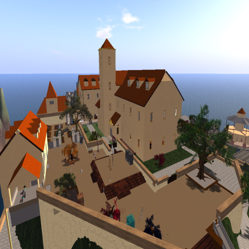 a large castle complex with orange roofs and interior courtyards.