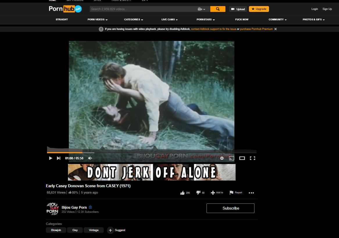 Web-screenshot from PornHub, with text 'Early Casey Donovan Scene from CASEY (1971).' Advertisements read 'DONT JERK OFF ALONE.'
